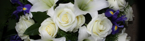 White Flowers at Funeral-500x143.jpg