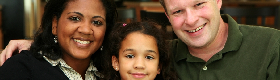 Interracial family portrait-907x260.JPG